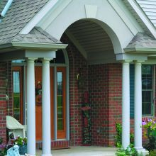 Tapered fiberglass columns support a residential entryway