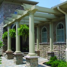 Tapered round fiberglass columns hold up a custom pergola