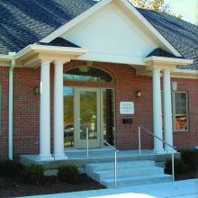 The entrance to a doctors office supports by fiberglass columns