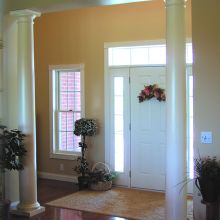 Fiberglass columns situated just inside the front door of a home
