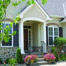 Both sides of a residential entryway are supported by tapered fiberglass columns
