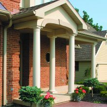 Load-bearing fiberglass columns support a residential porch