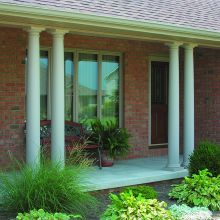 Two groups of fiberglass columns support a porch overhang