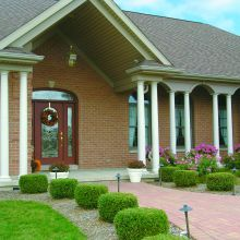 Several fiberglass tapered columns line a front porch