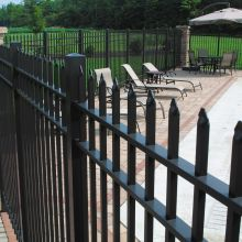 A speared aluminum fence stands ready to prevent intruders at a residential swimming pool