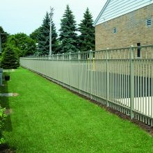 A residence separates their property from a neighboring business with an aluminum fence