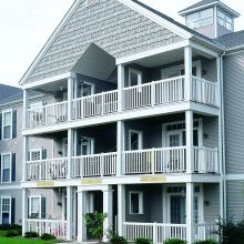 A multi-family residency features balconies protected by aluminum railing