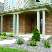 Panel style porch columns add load-bearing support to a residential location
