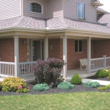 A combination of full sized panel columns, half columns, and railing finish a front porch