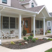 A series of square panel aluminum columns hold up to the weight of a front porch overhang