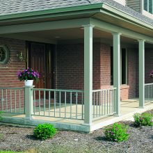Smooth porch columns mix with aluminum railing to finish off a front porch