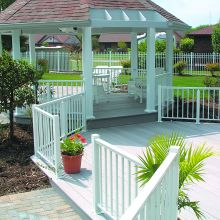 A residential gazebo has all sides supports by aluminum square smooth columns