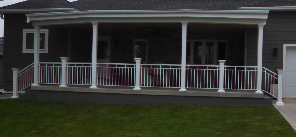Aluminum columns combine with aluminum railings on a front porch