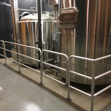 Pipe Railing surrounds brewing tanks at Moeller Brew Barn in Maria Stein, Ohio