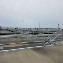 Numerous runs of safety pipe railing at a New York water treatment plant