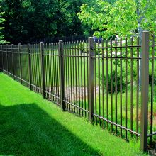 Aluminum picket fence keeps intruders out of a residential backyard