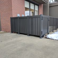 Privacy railing hides HVAC equipment in front of an Ohio business