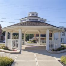 A public gazebo in a small Ohio town is held in place by load-bearing square smooth columns