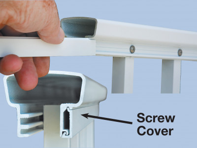 A screw cover being installed in square picket railing to conceal picket screws