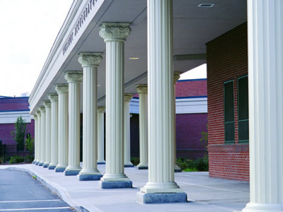 Round fluted columns supporting a long outdoor walkway