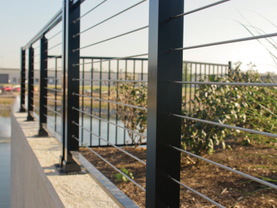 Cable railing covers an elevated outdoor area creating a safe an unimpeded view