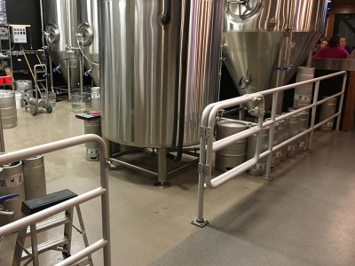 Brewing tanks at an Ohio brewery surrounded by pipe railing