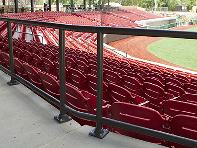 A view of pipe railing at a baseball stadium showing the non-welded construction of the railing
