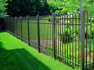 Spear picketed metal fence protects a residential yard