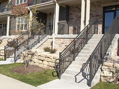 Heavy-duty stair railing sits ready to aid traversal of stairs at a Wisconsin apartment building