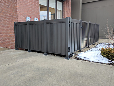 Privacy fence guards bulky equipment from prying eyes