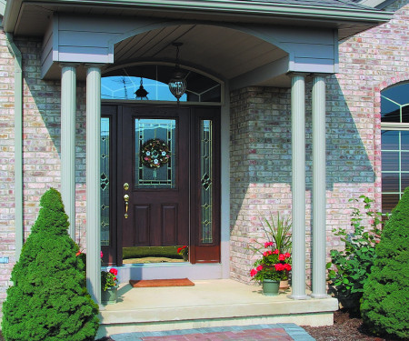 Two pairs of round fluted columns support a small entryway