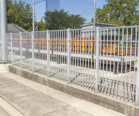 Aluminum picket fence surrounds a high school baseball field in Ohio