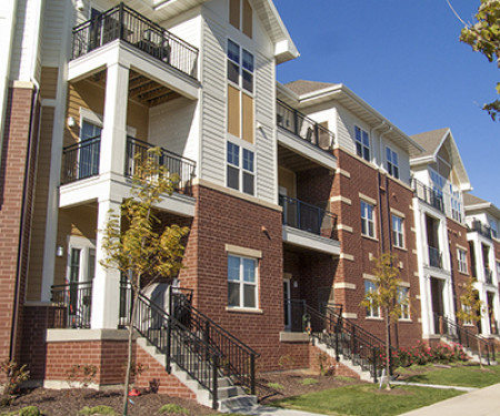 Heavy-duty step railing and balcony provide safety to a Wisconsin apartment building