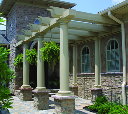 Tapered round fiberglass columns support a patio pergola