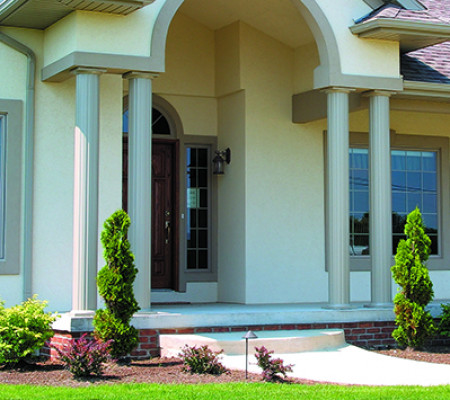 Round porch columns support the entryway to a home