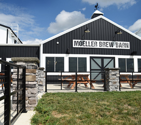 A Maria Stein Brewery features a patio surrounded by custom cable railing