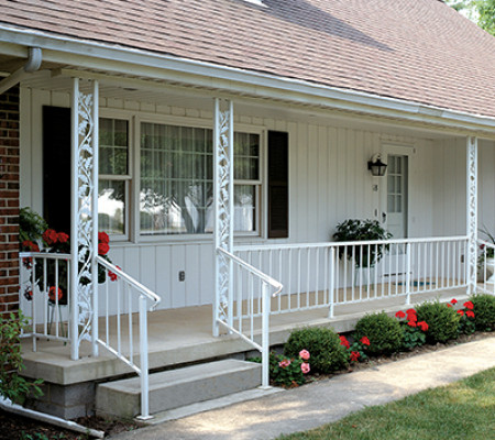 Decorative columns combine with residential style railing to complete a front porch