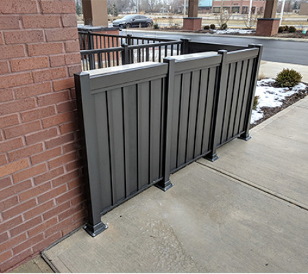 Privacy panel railing hides bulky HVAC units from sight
